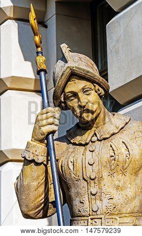 Halberdier statue next to the neo-baroque castle in Pszczyna, Silesia region, Poland.
