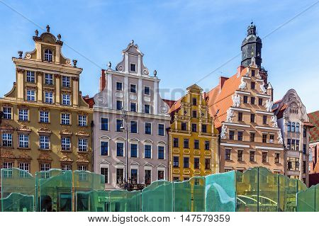 WROCLAW, POLAND - MARCH 19, 2016: Ancient tenements in the 13th century Main Market Square one of the largest markets in Europe with the largest two town halls in Poland.