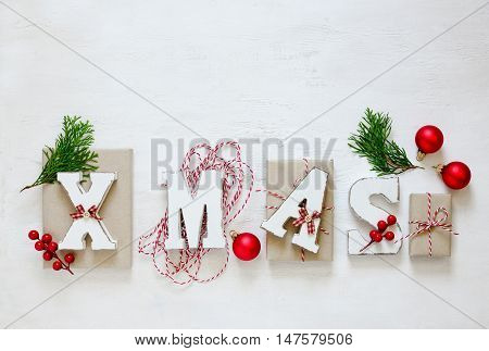 Xmas word made of wooden letters on a wooden background Cristmas leaflet or banner mockup space for a text flat lay top view