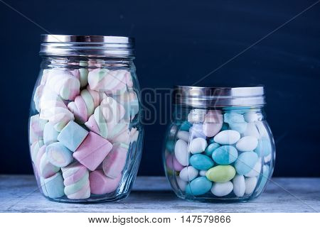 marshmallow and sugar coated almond candies in jars