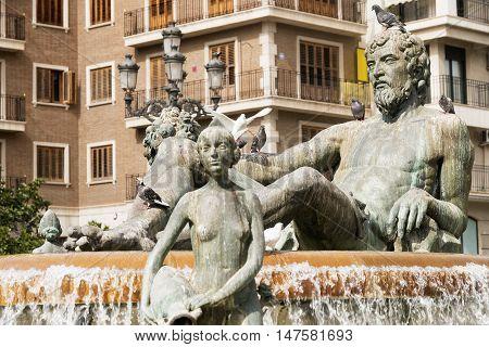 Valencia (Spain) historic fountain in plaza de la Virgen representing the Turia river