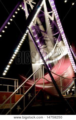 swing boat in action at night time