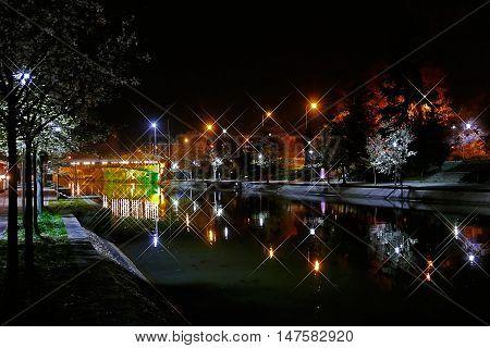 TIMISOARA ROMANIA - APRIL 1 2016: Night view of the illuminated river Bega in Timisoara Romania.