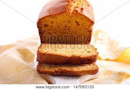 Cornmeal buttermilk loaf cake sliced on board