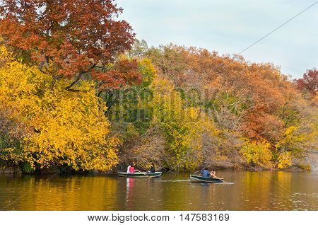 New York USA - November 14 2011: People renting a rowboat and enjoying beautiful autumn day in Central Park at New York City.