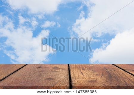 Perspective wood shelf on sky background for showing,advertising your work or product.