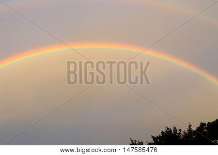 Beautiful rainbow in the sky after rain