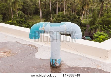 Old PVC air vent pipes on roof top of building