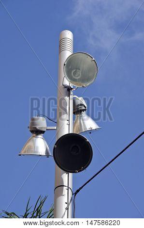 Modern lamp post against blue sky on sunny day