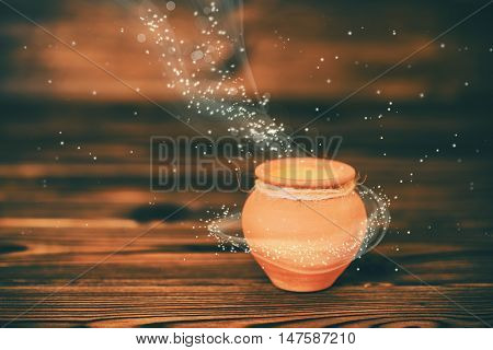 Concept Greeting Card Of Ceramic Pot With Mystical Miracle Light On Wooden Background, Beautiful Art