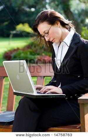 happy businesswoman working outside office