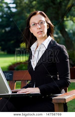 happy businesswoman working outside office