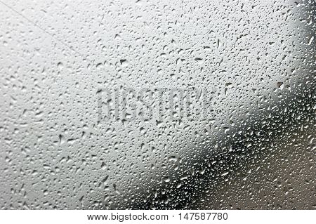 Window glass, covered with a multitude of raindrops