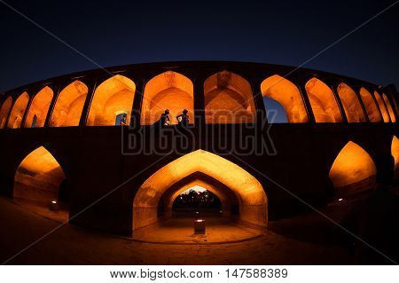 sunset time to historical stone bridge of 33 arches in isfahan, iran at September 15, 2016.