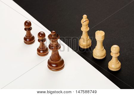 wooden chess pieces on black and white background abstract concept