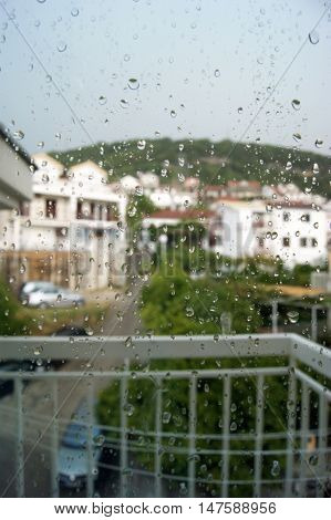 View of the street through the glass, wet from the rain