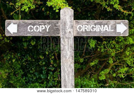 Copy Versus Original Directional Signs