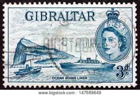 GIBRALTAR - CIRCA 1953: a stamp printed in Gibraltar shows Ocean Liner and Rock of Gibraltar circa 1953