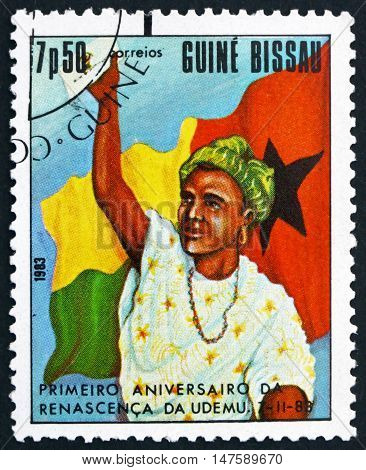 GUINEA-BISSAU - CIRCA 1983: a stamp printed in Guinea-Bissau shows Woman and Flag First Anniversary of Women's Federation circa 1983