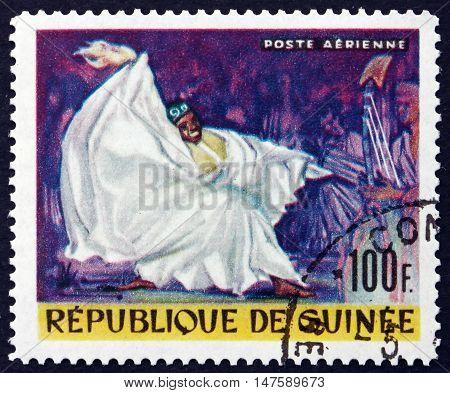 GUINEA - CIRCA 1966: a stamp printed in Guinea shows Kouyate Kandia National Singer circa 1966