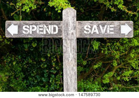 Spend Versus Save Directional Signs