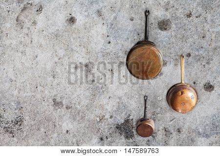 Copper kitchen utensils. kitchenware pot set. Aged wall background. copy space