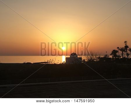 Lovely sunset in Paphos, Cyprus in a hot summers evening.