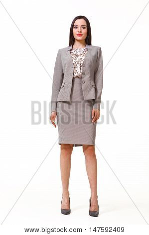 woman with straight hair style in gray official two pieces jacket and skirt suit high heels shoes full length body portrait standing isolated on white