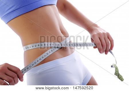 Close up of a woman waist measuring tape of slim beautiful lady white background