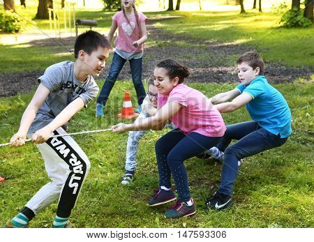 Moscow Russia - May 31 2016: Unidentified preteen kids play rope pull outdoor competition game in graduation school party in Moscow May 31 2016
