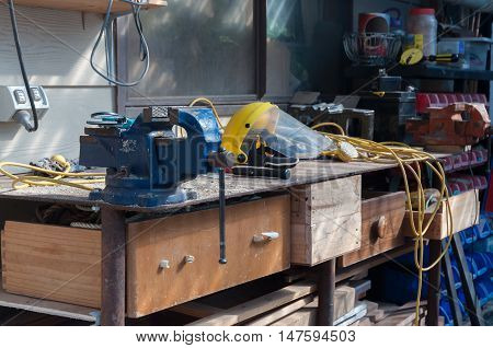 Workbench covered in sawdust and miscellaneous items.