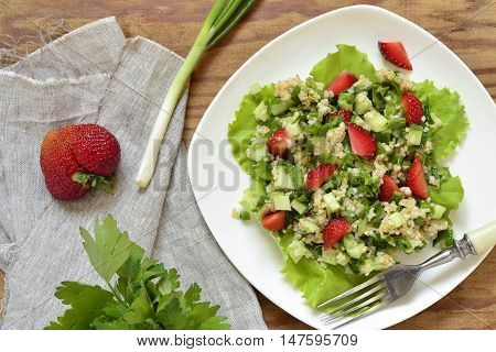 Tabbouleh with strawberries bulgur and vegetables,  top view