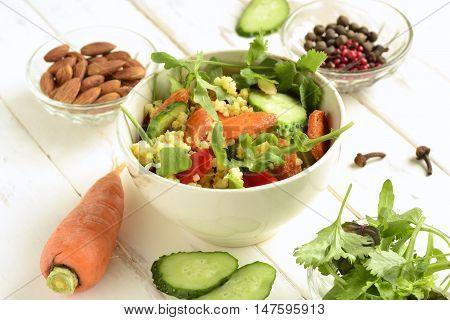 Moroccan salad: carrots millet herbs pepper, selective focus