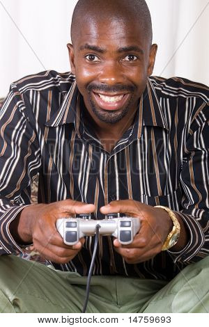 african man playing video game console controller