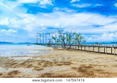 Wooden pier in beautiful beach kho Mak Island eastern Thailand.