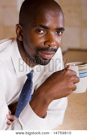 african businessman drinking coffee