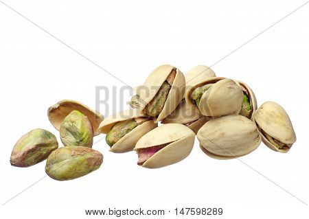Roasted and salted pistachio nuts isolated on white