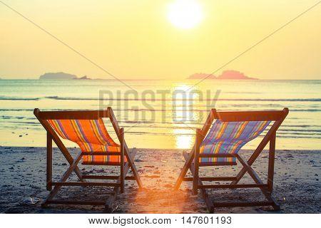 Two sunbeds on the sea beach.