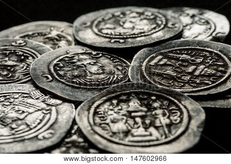 Silver Coins Af Ancient Persia On A Black Background