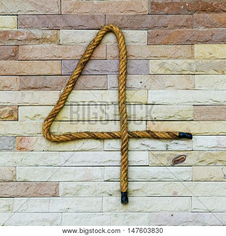 Rope Number four Alphabet on stone background