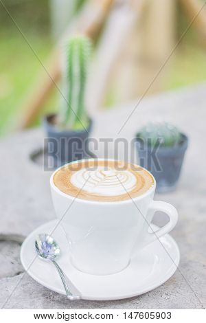 Cappuccino or latte coffee with heart shape coffee lover image for background