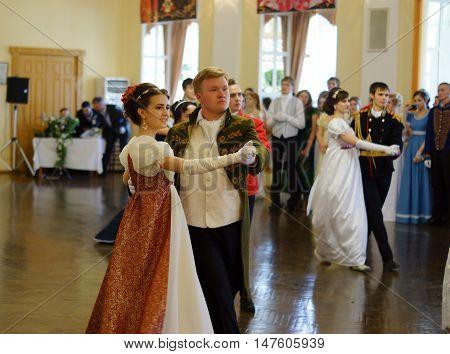 May 15, Ryazan city, Gorky library, General Assambley. beautiful girl and man in ancient dress for the ballroom