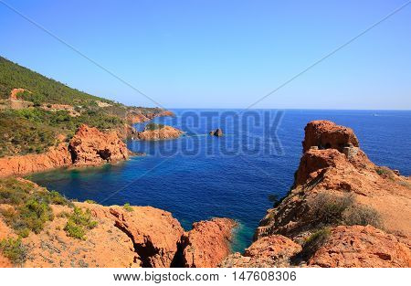 Esterel mediterranean red rocks coast beach and sea. French Riviera in Cote d Azur near Cannes Saint Raphael Provence France Europe