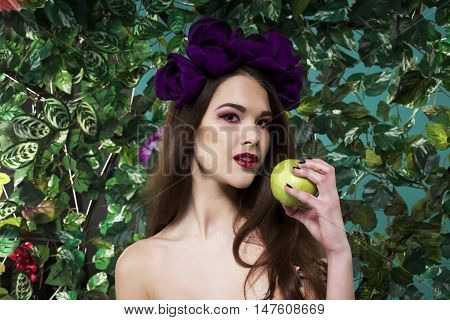beautiful girl with a wreath on his head with apple
