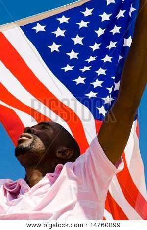 young african american man waving a USA flag