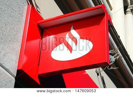 Cardiff, Wales, UK, August 31, 2016: Santander bank advertising sign outside their retail branch in Queen Street