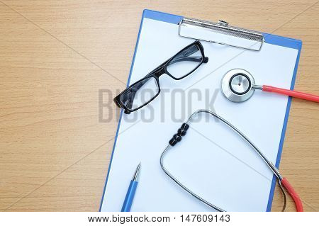 stethoscope medical documents with pen and glasses