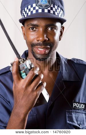 south african policeman using police radio