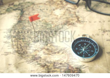 Compass on old map vintage tone style