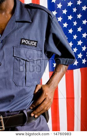 police officer, background is american flag